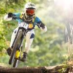 Mountainbiker rides in forest...