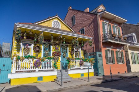 Old Colonial Houses on the Streets of French Quarter decorated for Mardi Gras in New Orleans,  Louisiana