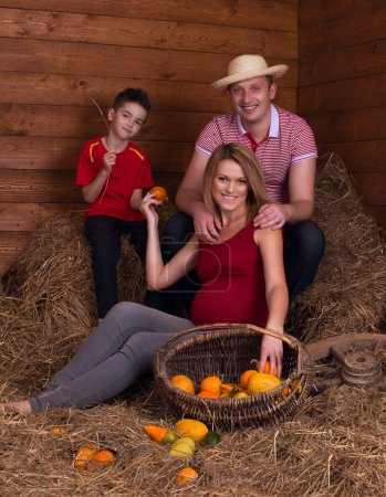 Family in the hayloft with fruit