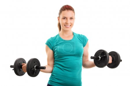 Young girl holding two barbells