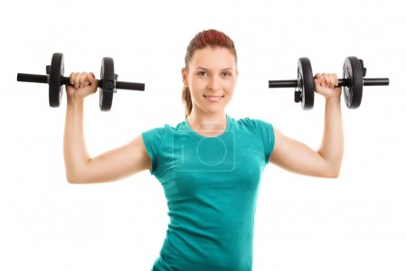 Young girl holding up two barbells