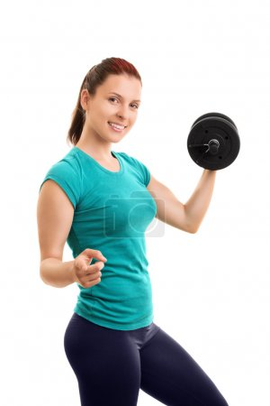Photo for I pull my weight. I exercise. Do you?Beautiful young girl lifting weights and pointing towards you, isolated on white background. - Royalty Free Image