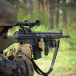 Sniper with machine gun waiting in ambush...