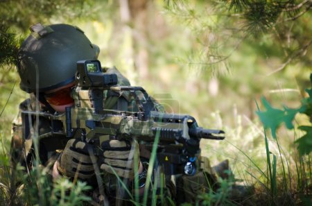 Bundeswehr soldier armed and ready to shoot from a...