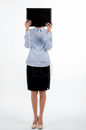Formally dressed woman covers face.