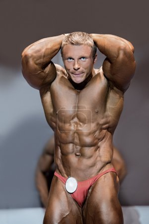 Muscular male flexing abs.