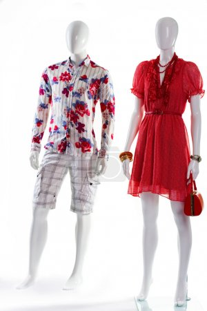 Dress and shirt on mannequins.
