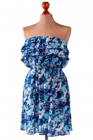 Photo for Strapless blue summer dress. Floral dress on beige mannequin. Ladys blue casual dress. Nice discounts in outlet shop. - Royalty Free Image