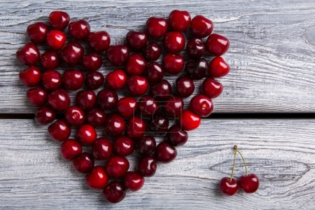 Heart made of dark cherries.