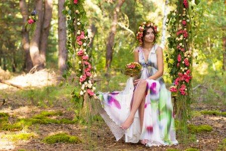 Pretty woman in wreath of flowers.
