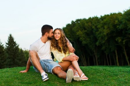 Guy and girl hugging in the park. Evening date.