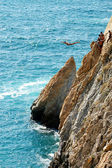 Group of cliff divers in free fly, Acapulco, Mexico.