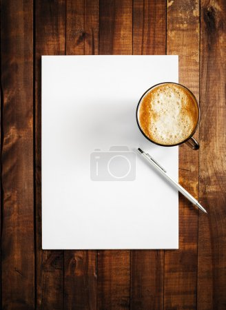 Blank letterhead, coffee and pen