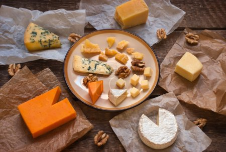 Assorted cheeses on the wooden table