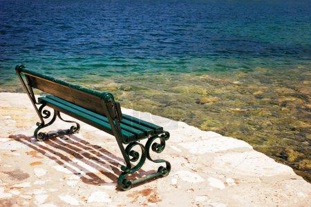 Empty bench on the stone embankment
