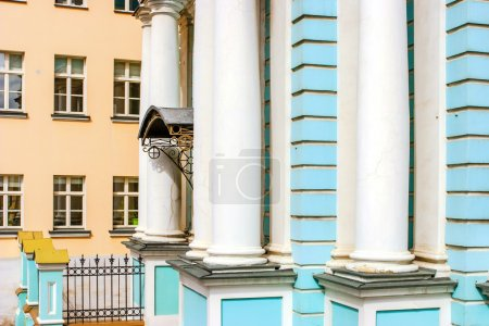 Detail of facade of the blue church with white pillars in Russia