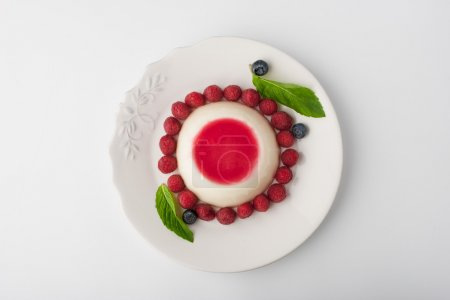 Panna cotta with berries and mint top view