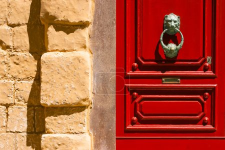 Red maltese door with old forged habdle