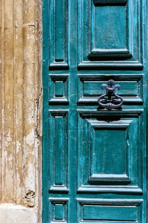 Blue maltese door with old forged handle