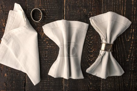 Set of the napkins with vintage rings on the wooden table horizontal