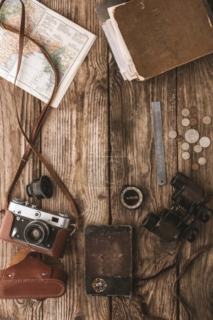 Set of things for travel on the wooden background top view