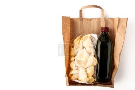 Pasta and olive oil inside a paper bag