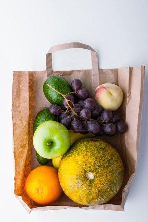 Different fruit inside a paper bag