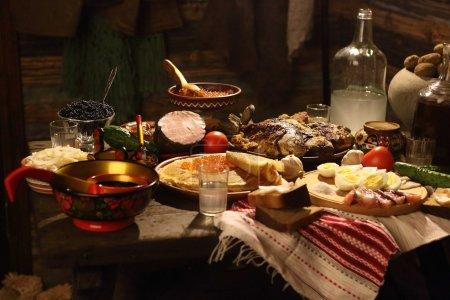 Photo pour Crêpes, caviar, poisson frit et vodka sur une table festive - image libre de droit