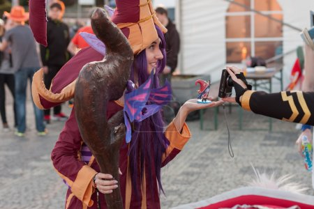 Cosplayer dressed as character Lulu from game League of Legends