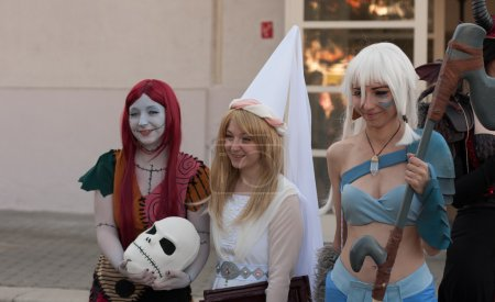 Group of cosplayers poses at