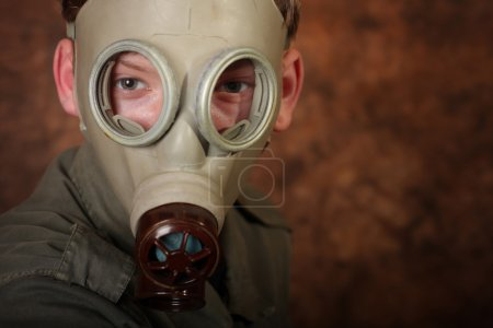 Man with gas mask on brown batik  background