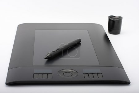 Graphic tablet and pen and stand for nibs on white...