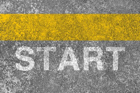 Photo for Yellow start line is on the asphalt road. - Royalty Free Image