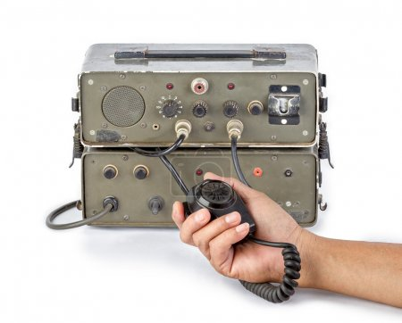 dark green amateur ham radio holding in hand on white background