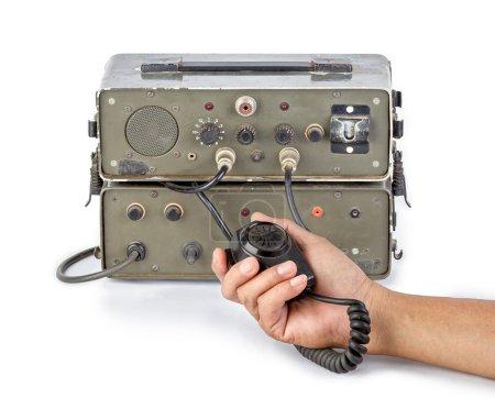 dark green amateur ham radio holding in hand on white background