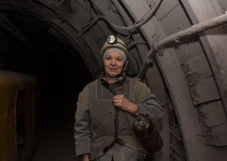 Donetsk, Ukraine - March, 14, 2014: Woman surveyor in the underg