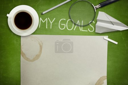 My goals concept on green blackboard with coffee cup
