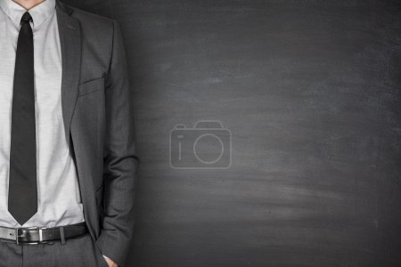 Photo for Businessman with suit and tie front of Blackboard - Royalty Free Image