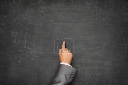 Blank blackboard with businessman hand pointing