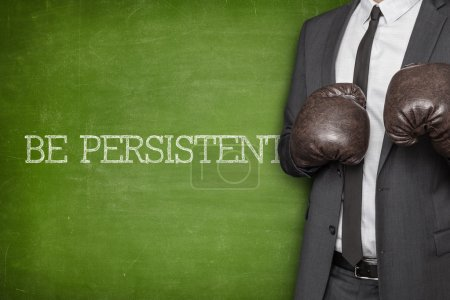Photo for Be focused on blackboard with businessman wearing boxing gloves - Royalty Free Image