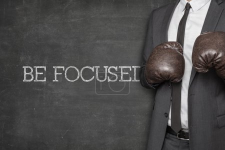 Be focused on blackboard with businessman