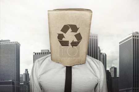 Recycling icon on paper bag what businessman is wearing on head