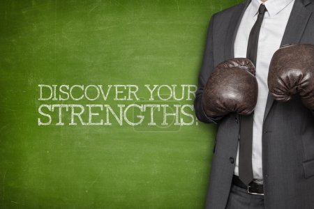 Photo for Discover your strengths on blackboard with businessman wearing boxing gloves - Royalty Free Image