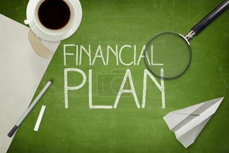 Financial plan concept on blackboard with empty paper sheet