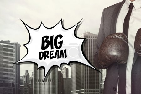 Big dream text with businessman wearing boxing gloves