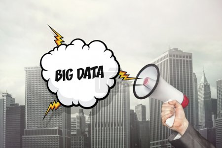 Big data text on speech bubble and businessman hand holding megaphone