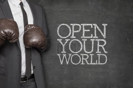 Open your world on blackboard with businessman on side