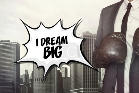 I dream big text with businessman wearing boxing gloves