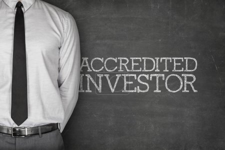 Accredited investor text on blackboard with busine...