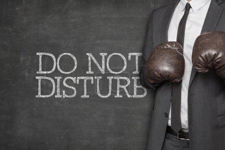 Do not disturb on blackboard with businessman on side
